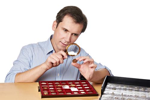 man examining coin
