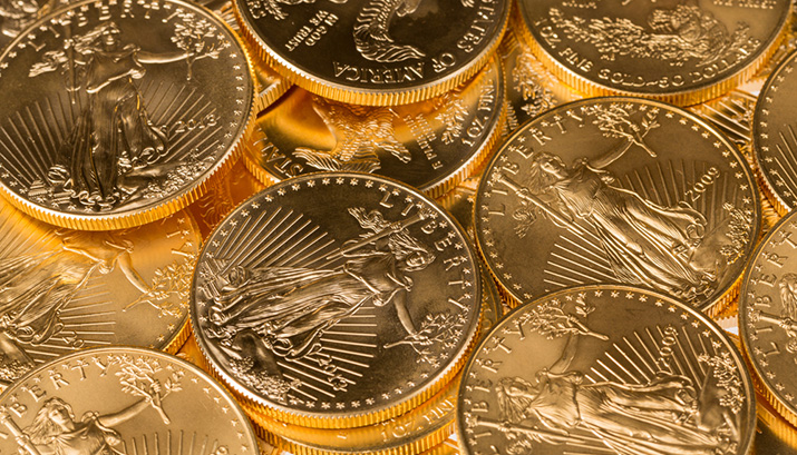 stacks of gold eagle coins