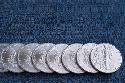 Row of American silver dollars