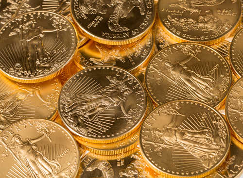 Stacks of gold eagle one troy ounce golden coins